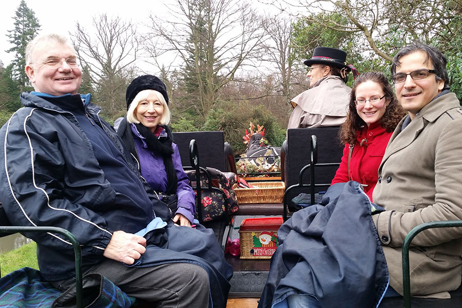 Guests aboard the carriage on a Winter tour